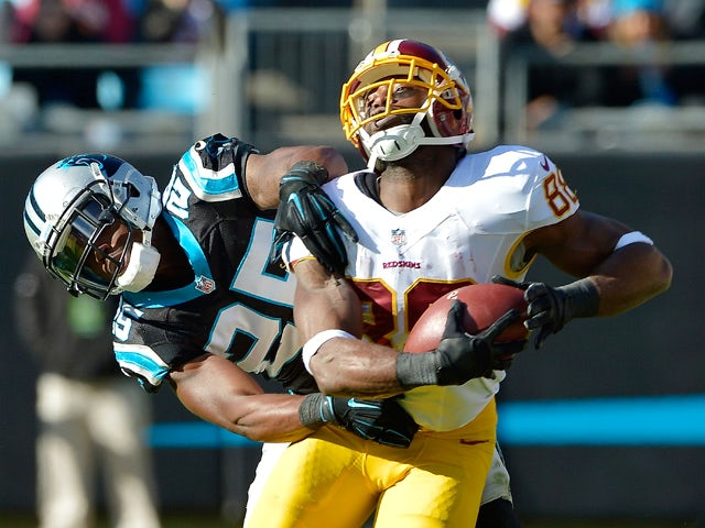 Bene' Benwikere #25 of the Carolina Panthers defends a pass to Pierre Garcon #88 of the Washington Redskins during their game at Bank of America Stadium on November 22, 2015