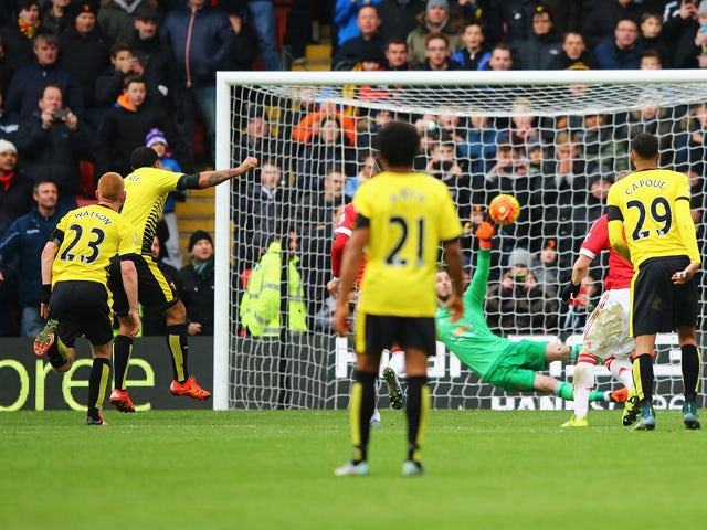 Troy Deeney of Watford scores his team's first goal from the penalty spot during the Barclays Premier League match between Watford and Manchester United at Vicarage Road on November 21, 2015