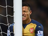Arsenal's Alexis Sanchez grimaces during the Premier League defeat to West Bromwich Albion on November 21, 2015