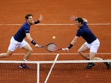 Andy Murray (L) and Jamie Murray (R) of Great Britain compete in the doubles match against David Goffin and Steve Darcis of Belgium on day two of the Davis Cup Final 2015 at Flanders Expo on November 28, 2015