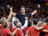 Britain's Andy Murray (C) celebrates with teammates after winning his tennis match against Belgium's David Goffin to win the Davis Cup final between Belgium and Britain at Flanders Expo in Ghent on November 29, 2015