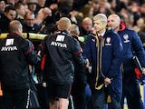 Arsene Wenger manager of Arsenal shakes hands with the Norwich City team bench after the Barclays Premier League match between Norwich City and Arsenal at Carrow Road on November 29, 2015