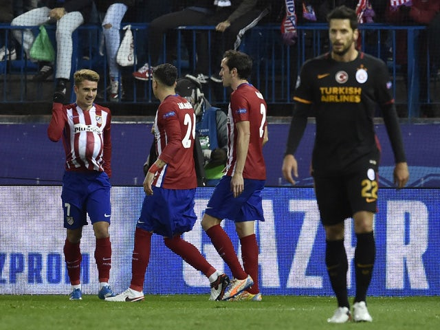 Atletico Madrid's French forward Antoine Griezmann (L) celebrates a goal with teammates during the UEFA Champions League Group C football match Club Atletico de Madrid vs Galatasaray AS at the Vicente Calderon stadium in Madrid on November 25, 2015
