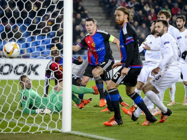 Fiorentina's Italian goalkeeper Luigi Sepe (L) concedes a goal to Basel's Czech defender Marek Suchy (C) during the UEFA Europa League group I football match between Basel and Fiorentina at the St Jakob stadium in Basel on November 26, 2015.