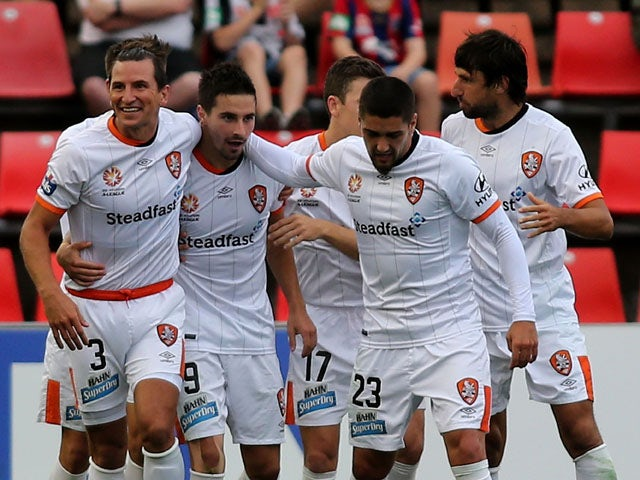 Brisbane Roar players celebrate a goal during the round eight A-League match between the Newcastle Jets and Brisbane Roar at Hunter Stadium on November 28, 2015