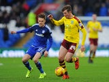 Chris Long of Burnley is tackled by Craig Noone of Cardiff City during the Sky Bet Championship match between Cardiff City and Burnley at the Cardiff City Stadium on November 28, 2015