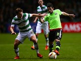 James Forrest of Celtic challenges Amin Younes of Ajax during the UEFA Europa League Group A match between Celtic FC and AFC Ajax on November 26, 2015 in Glasgow, Scotland.