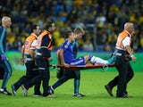 John Terry of Chelsea leaves the field on a stretcher during the UEFA Champions League Group G match between Maccabi Tel-Aviv FC and Chelsea FC at Sammy Ofer Stadium on November 24, 2015