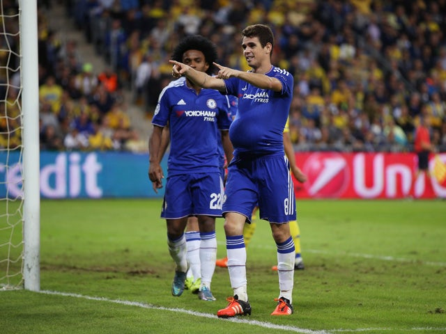 Oscar of Chelsea celebrates scoring his teams third goal during the UEFA Champions League Group G match between Maccabi Tel-Aviv FC and Chelsea FC at Sammy Ofer Stadium on November 24, 2015