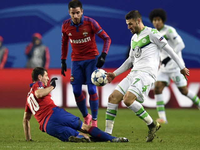 CSKA Moscow's Russian midfielder Alan Dzagoev (L) vies for the ball with Wolfsburg's German midfielder Daniel Caligiuri during the UEFA Champions League group B football match between PFC CSKA Moskva and VfL Wolfsburg at the Arena Khimki stadium outside M