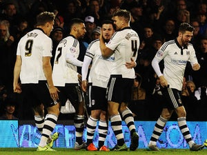 Ross McCormack (C) of Fulham celebrates with team mates after scoring during the Sky Bet Championship match between Fulham and Preston North End at Craven Cottage on November 28, 2015