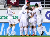 Real Madrid's Welsh forward Gareth Bale (2nd R) celebrates a goal with teammates during the Spanish league football match SD Eibar vs Real Madrid CF at the Ipurua stadium in Eibar on November 29, 2015.