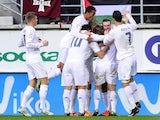 Real Madrid's Welsh forward Gareth Bale (2nd R) celebrates a goal with teammates during the Spanish league football match SD Eibar vs Real Madrid CF at the Ipurua stadium in Eibar on November 29, 2015.