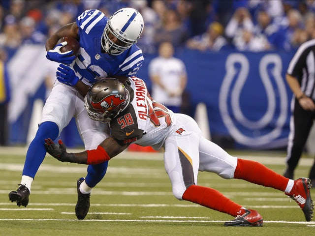 Frank Gore #23 of the Indianapolis Colts is tackled by Kwon Alexander #58 of the Tampa Bay Buccaneers at Lucas Oil Stadium on November 29, 2015