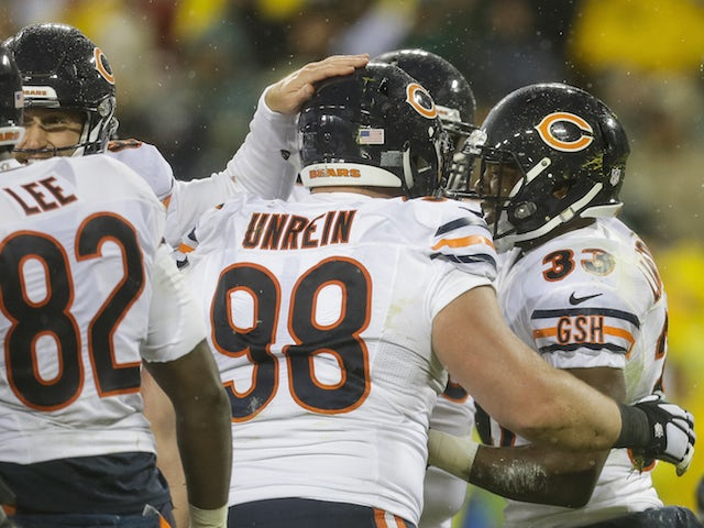 Jeremy Langford #33 of the Chicago Bears celebrates with teammates after scoring a touchdown in the second quarter against the Green Bay Packers at Lambeau Field on November 26, 2015 in Green Bay, Wisconsin.