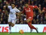 Liverpool's English midfielder Jordon Ibe (R) vie with Swansea City's Welsh defender Neil Taylor during the English Premier League football match between Liverpool and Swansea City at the Anfield stadium in Liverpool, north-west England on November 29, 20