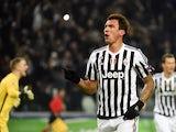 Juventus' forward from Croatia Mario Mandzukic celebrates after scoring during the UEFA Champions League football match Juventus vs Manchester City on November 25, 2015