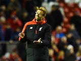 Liverpool's German manager Jurgen Klopp applauds, on the pitch after the English Premier League football match between Liverpool and Swansea City at the Anfield stadium in Liverpool, north-west England on November 29, 2015