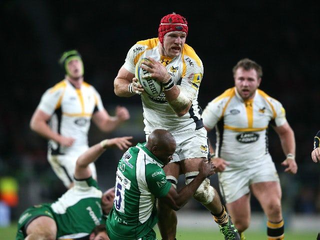 James Haskell of Wasps is tackled by Topsy Ojo during the Aviva Premiership match between London Irish and Wasps at Twickenham Stadium on November 28, 2015 in London, England.