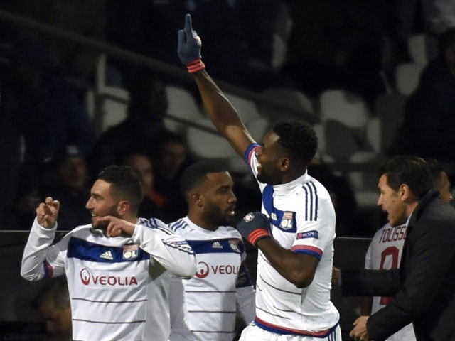 Lyon's French midfielder Jordan Ferri (L) celebrates with teammates after scoring a goal during the UEFA Champions League group H football match between Lyon and Gent on November 24, 2015