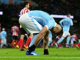 Sergio Aguero of Manchester City picks up an injury during the Barclays Premier League match between Manchester City and Southampton at the Etihad Stadium on November 28, 2015