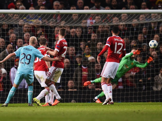 David De Gea of Manchester United makes a save from Jorrit Hendrix of PSV Eindhoven (29) during the UEFA Champions League Group B match between Manchester United FC and PSV Eindhoven at Old Trafford on November 25, 2015