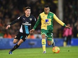 Martin Olsson of Norwich City is chased by Hector Bellerin of Arsenal during the Barclays Premier League match between Norwich City and Arsenal at Carrow Road on November 29, 2015 in Norwich, England.