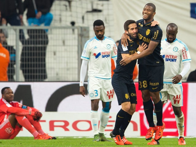 Monaco's Malian defender Almamy Toure (2nd R) celebrates with Monaco's Portuguese midfielder Joao Moutinho after scoring during the French L1 football match Olympique de Marseille vs AS Monaco on November 29, 2015