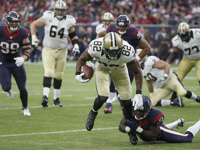 Benjamin Watson #82 of the New Orleans Saints is tackled by Johnathan Joseph #24 of the Houston Texans in the second quarter on November 29, 2015