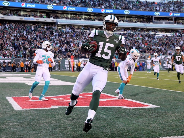 Brandon Marshall #15 of the New York Jets celebrates his touchdown in the first quarter against the Miami Dolphins on November 29, 2015
