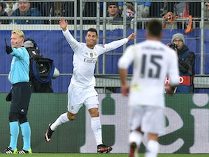 Real Madrid's Portuguese forward Cristiano Ronaldo celebrates after scoring during the UEFA Champions League group A football match between Shakhtar Donetsk and Real Madrid in Lviv on November 25, 2015