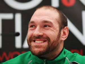 Tyson Fury talks to the media during a Tyson Fury - Christian Hammer head-to-head press conference at Fredericks Resturant on January 20, 2015