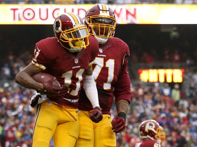 Wide receiver DeSean Jackson #11 of the Washington Redskins celebrates with tackle Trent Williams #71 after scoring a second quarter touchdown against the New York Giants at FedExField on November 29, 2015