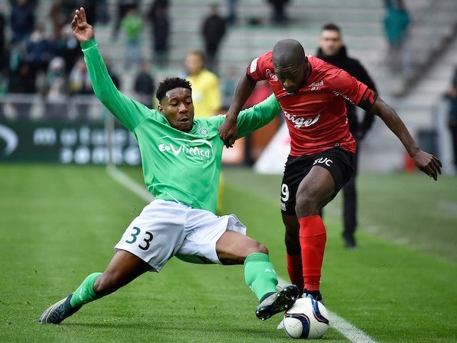 Guingamp's French midfielder Yannis Salibur (R) vies for the ball against Saint-Etienne's French defender Ronael Pierre Gabriel (L) during the French L1 football match AS Saint-Etienne (ASSE) vs Guingamp on November 29, 2015, at the Geoffroy Guichard Stad