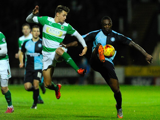 Anthony Stewart of Wycombe Wanderers is tackled by Harry Cornick of Yeovil Town during the Sky Bet League Two match between Yeovil Town and Wycombe Wanderers at Huish Park on November 24, 2015