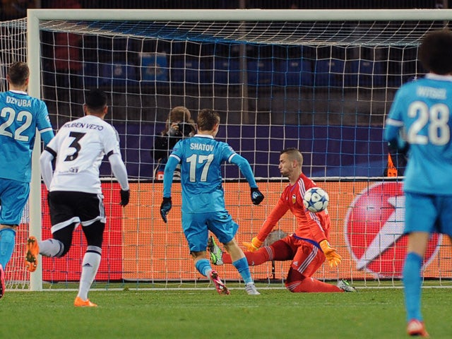 Zenit's Russian midfielder Oleg Shatov (C) scores a goal past Valencia's goalkeeper Jaume Domenech during the UEFA Champions League group H football match between FC Zenit and Valencia CF at the Petrovsky stadium in St Petersburg on November 24, 2015