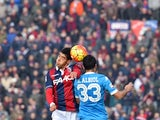 Bologna's defender from Morocco Adam Masina (L) jumps for the ball with Napoli's defender from Spain Raul Albiol during the Italian Serie A football match Carpi vs AC Milan at the Dall'Ara stadium in Bologna on December 6, 2015.