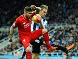 Alberto Moreno of Liverpool and Siem de Jong of Newcastle United challenge for the ball during the Barclays Premier League match between Newcastle United and Liverpool at St James' Park on December 6, 2015 in Newcastle upon Tyne,