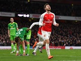 Aaron Ramsey of Arsenal celebrates scoring his team's third goal during the Barclays Premier League match between Arsenal and Sunderland at Emirates Stadiumon December 5, 2015