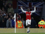 Arsenal's Costa Rican striker Joel Campbell celebrates scoring his team's first goal during of the English Premier League football match between Arsenal and Sunderland at the Emirates Stadium in London on December 5, 2015