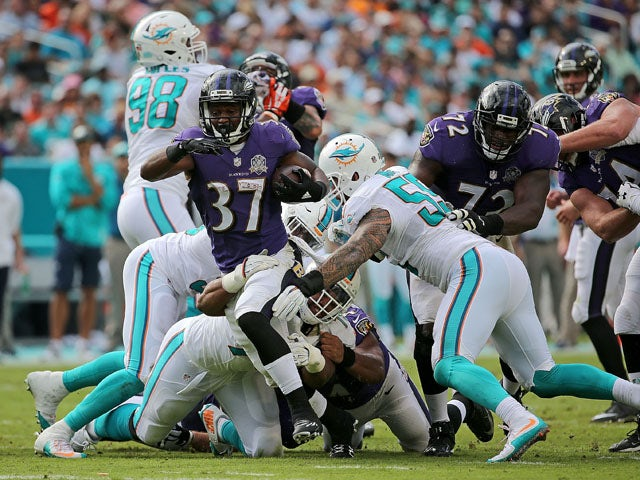 Javorius Allen #37 of the Baltimore Ravens rushes during a game against the Miami Dolphins at Sun Life Stadium on December 6, 2015