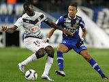 Bordeaux's French forward Henri Saivet (L) vies with Bastia's French midfielder Axel Ngando during the L1 football match Bastia (SCB) against Bodeaux (GDB) on December 2, 2015, at the Armand Cesari stadium in Bastia, on the French Mediterranean island of