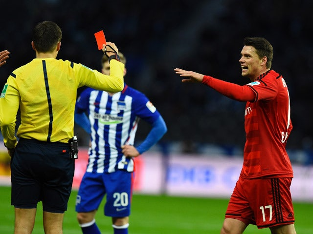 Leverkusen's Polish defender Sebastian Boenisch leaves after red card during the German first division Bundesliga football match Herta Berlin vs Leverkusen in Berlin on December 5, 2015