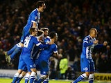 Tomer Hemed of Brighton celebrates with team mates after scoring the teams third and winning goal of the game during the Sky Bet Championship match between Brighton and Hove Albion and Charlton Athletic at The Amex Stadium on December 05, 2015