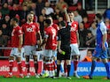 Nathan Baker of Bristol City (2nd L) is sent off during the Sky Bet Championship match between Bristol City and Blackburn Rovers at Ashton Gate on December 5, 2015