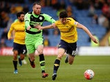 Callum O'Dowda of Oxford holds off pressure from Sam Wedgbury of Forest Green during The Emirates FA Cup Second Round match between Oxford United and Forest Green at Kassam Stadium on December 6, 2015 in Oxford, England.