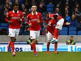 Charlton's Ademola Lookman celebrates with team Reza Ghoochannejhad after scoring the teams first goal during the Sky Bet Championship match between Brighton and Hove Albion and Charlton Athletic at The Amex Stadium on December 05, 2015