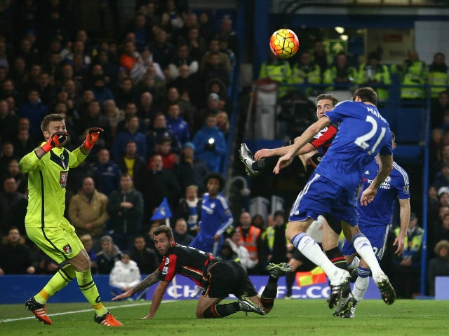 Chelsea's Serbian midfielder Nemanja Matic (R) heads the ball over the bar during the English Premier League football match between Chelsea and Bournemouth at Stamford Bridge in London on December 5, 2015.