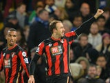 Bournemouth's English striker Glenn Murray (R) celebrates after scoring during the English Premier League football match between Chelsea and Bournemouth at Stamford Bridge in London on December 5, 2015.