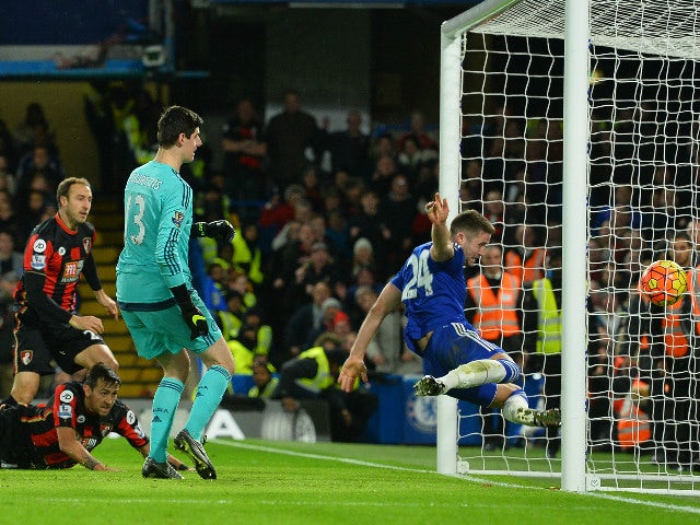 Bournemouth's English striker Glenn Murray (L) scores past Chelsea's English defender Gary Cahill (R) during the English Premier League football match between Chelsea and Bournemouth at Stamford Bridge in London on December 5, 2015.
